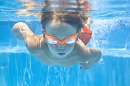 image of boy swimming underwater