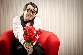 image of guy on couch with roses